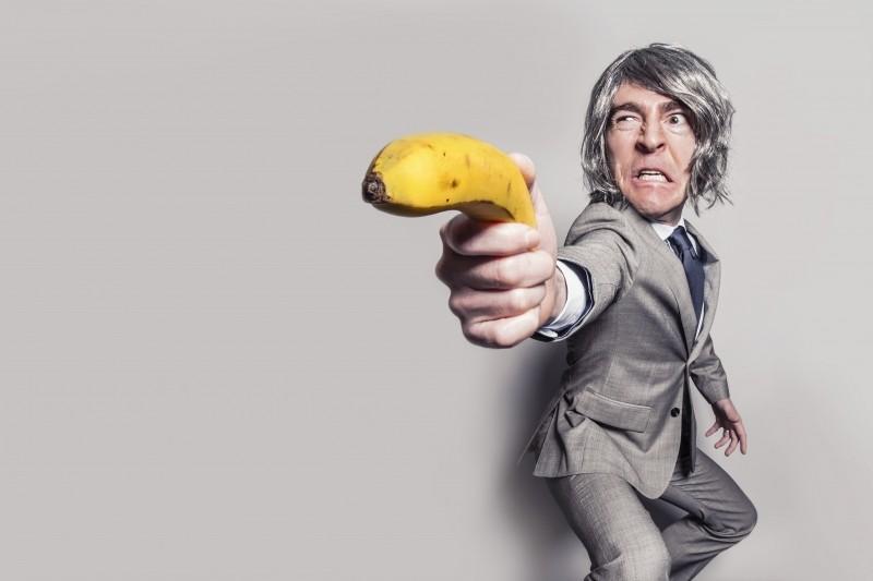 businessman-aiming-with-banana (1)